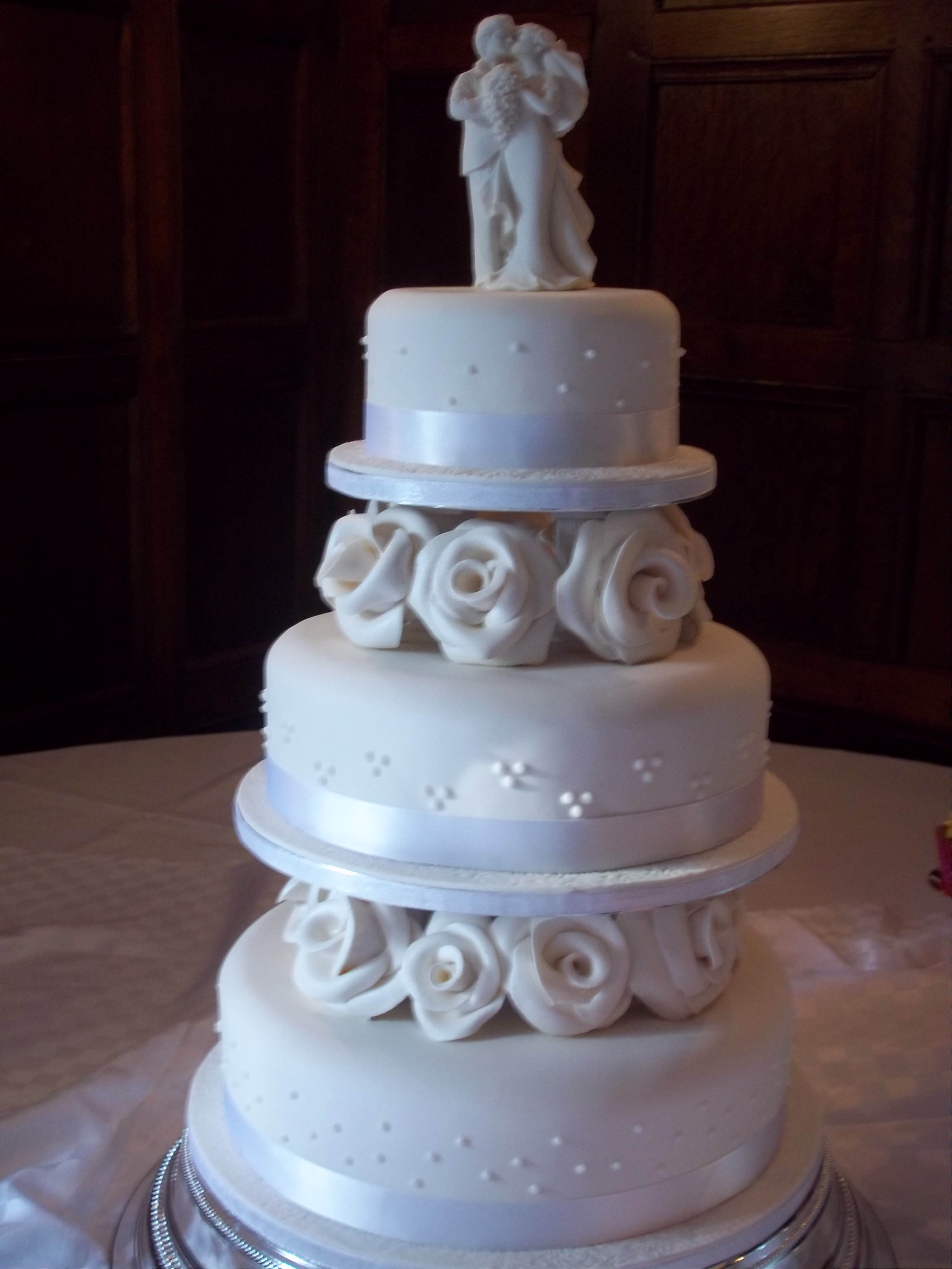 Traditional separated three tier with pillars and roses